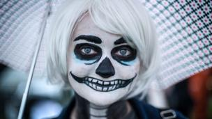 A woman with skeleton face paint