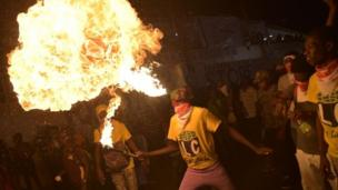 A fire-throwers performs in Port-au-Prince, Haiti. Photo: 28 February 2017