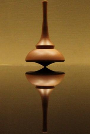 A balancing spinning top