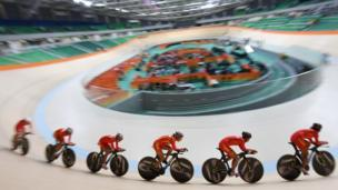 The Chinese women's track cycling team practises during a training session in the Olympic Velodrome