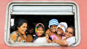 Sri Lankan family in train window