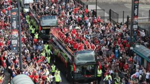Fans watching the Wales football team on their open-top bus