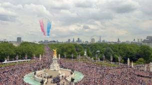 The RAF fly-past roared down The Mall and over the top of Buckingham Palace to cheers from the crowd below.