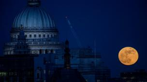 Supermoon rises behind London's St Paul's cathedral