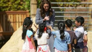 The Duchess of Cambridge talks to children in the Magic Garden.