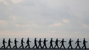 Crew march on flight deck