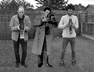 A family holding a camera