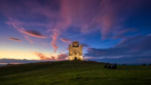 A spectacular sunset behind Paxton's Tower in Carmarthenshire