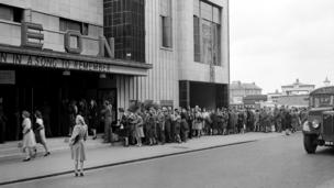 Cinema-goers queue outside the Odeon Cinema in Reading, 1945.