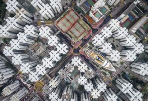 "This aerial image of Hong Kong won Andy Yeung second place. It was inspired by the the Kowloon Walled City, a notoriously dense city that was demolished in the 1990s. ""If you look hard enough, you will notice that the city is not dead,"" he said. ""Part of it still exists.... I hope this series can get people to think about claustrophobic living in Hong Kong from a new perspective."""