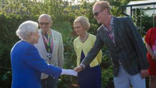 The Queen meets television presenters Chris Evans and Mary Berry