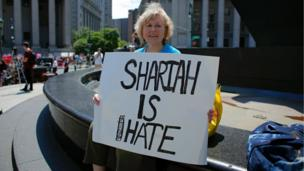 A Trump supporter holds up a sign during an anti-sharia law rally origanized by ACT for America on June 10, 2017 at Foley square in New York.