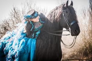 A picture of a horse and rider, posted on Facebook by Sophie Callahan Photography, as part of the #blueforBonnie campaign