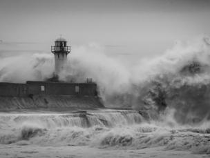 Waves breaking on a harbour wall