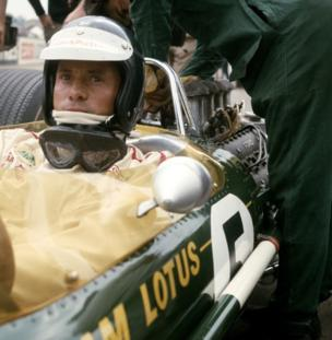 Jim Clark , who sits aboard the Team Lotus Lotus 49 Ford Cosworth DFV 3.0 V8 before the start of the British Grand Prix on 15th July 1967 at the Silverstone circuit