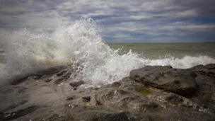 Waves crash on rocks at Ogmore-by-Sea, Vale of Glamorgan, captured by Mark Tugwell