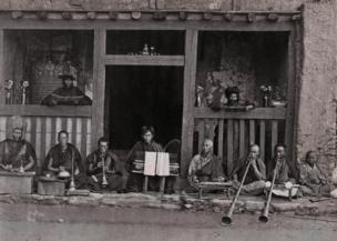 A row of buddhist Musicians, Darjeeling