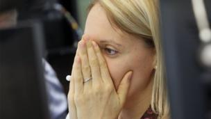 A broker reacts at the German stock exchange in Frankfurt, Germany