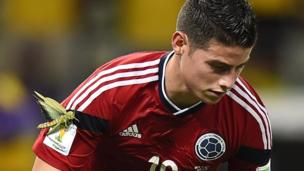 James Rodriguez with a large insect on his arm