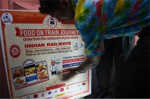 In this photograph taken on May 22, 2017, Indian staff prepare a food trolley onboard the Tejas Express luxury train during its first journey between Mumbai and Goa in Mumbai