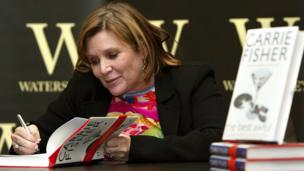 Carrie Fisher signs her book The Best Awful at a promotional event in London on 20 Feb 2004