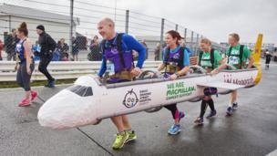 Runners dressed as aeroplane