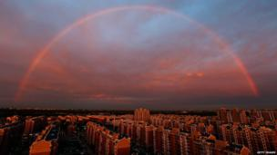 A rainbow appears over the city on August 3, 2015 in Beijing, China.