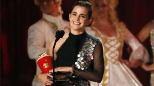 "Emma Watson accepts the Best Actor in a Movie award for ""Beauty and the Beast."""