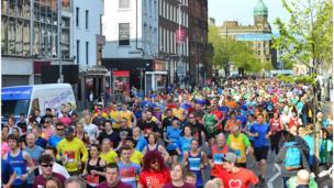 Runners start the Belfast City Marathon, Belfast City Hall, 1 May 2017