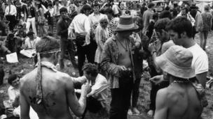 27th August 1967: Painted, beaded and colourfully dressed, the peace-loving Flower People gather at a music festival in the grounds of Woburn Abbey, in the south of England
