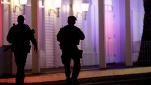 armed police officers walking outside casino on Las Vegas Strip