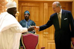 Nigerian President Olusegun Obasanjotoasts with Prince Philip, Duke of Edinburgh, during a reception in honour of Britain's Queen Elizabeth II at the State House in Abuja, Nigeria, 3 December 2003.