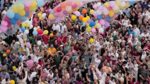Egyptians release balloons at the end of prayers in Cairo.