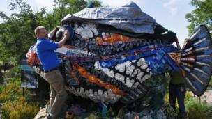 A Fish on display made completely out of plastic gathered from beaches