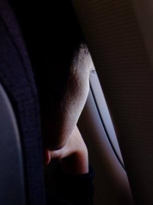 Woman looking out of the window on an aeroplane