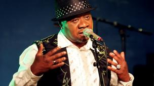 Papa Wemba performs on stage in Paris, in 2006