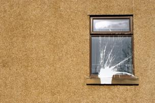 White paint splattered against a window