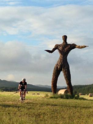 Jamie on his evening cycle passing Wickerman festival site in Dundrennan.