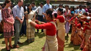 Prince William and his wife Catherine, the Duchess of Cambridge, watch a traditional dance in Panbari village in Kaziranga