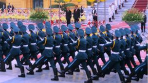 Japan's Emperor Akihito (L) and Vietnamese President Tran Dai Quang watch honour guards march during an official welcoming ceremony at the presidential palace in Hanoi on March 1, 2017. Japan's emperor and empress departed February 28 for their first trip to Vietnam to meet families of former Japanese soldiers to help heal wounds left over from its occupation of the country during World War II