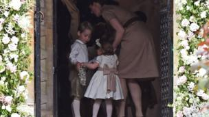 prince George and princess Charlotte stand with their nanny Maria Borrallo