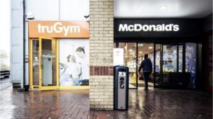 A McDonald's next to a gym