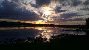 Dramatic skies reflected in the water at Port Meadow, Oxford.