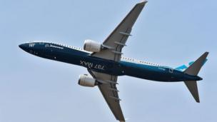 A Boeing 737 Max 9 jet airliner performs its flight display at Le Bourget on June 20, 2017
