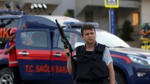 A plain clothes policeman holds a gun in Marmaris