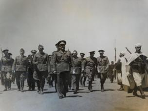 General Franco marches flanked by troops and von Richthofen at the Barajas airport, Madrid.