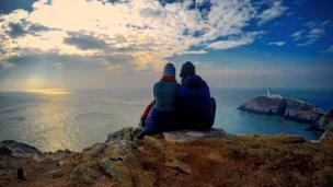 A couple admire the view at South Stack, Anglesey