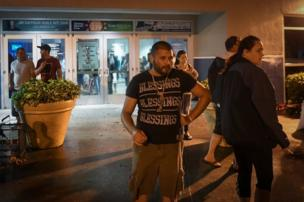 People dey smoke cigar outside di Germain Arena, where dey keep people to stay during hurricane Irma for Estero, Florida, 10 September