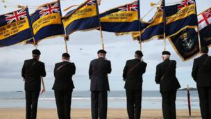 Members of the British Legion took part in a poppy drop ceremony on East Strand beach during the show
