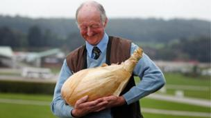 Man holding a Giant Onion